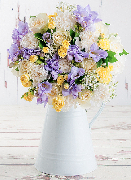 Banish Your January Blues flower arrangement in a jug