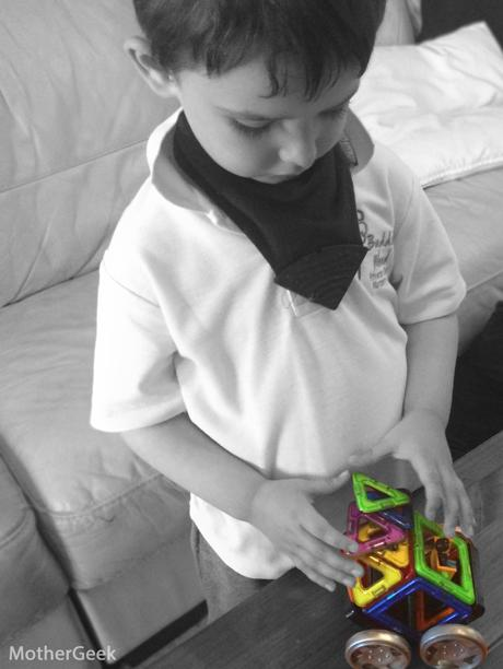 Autistic Child playing with Magformers