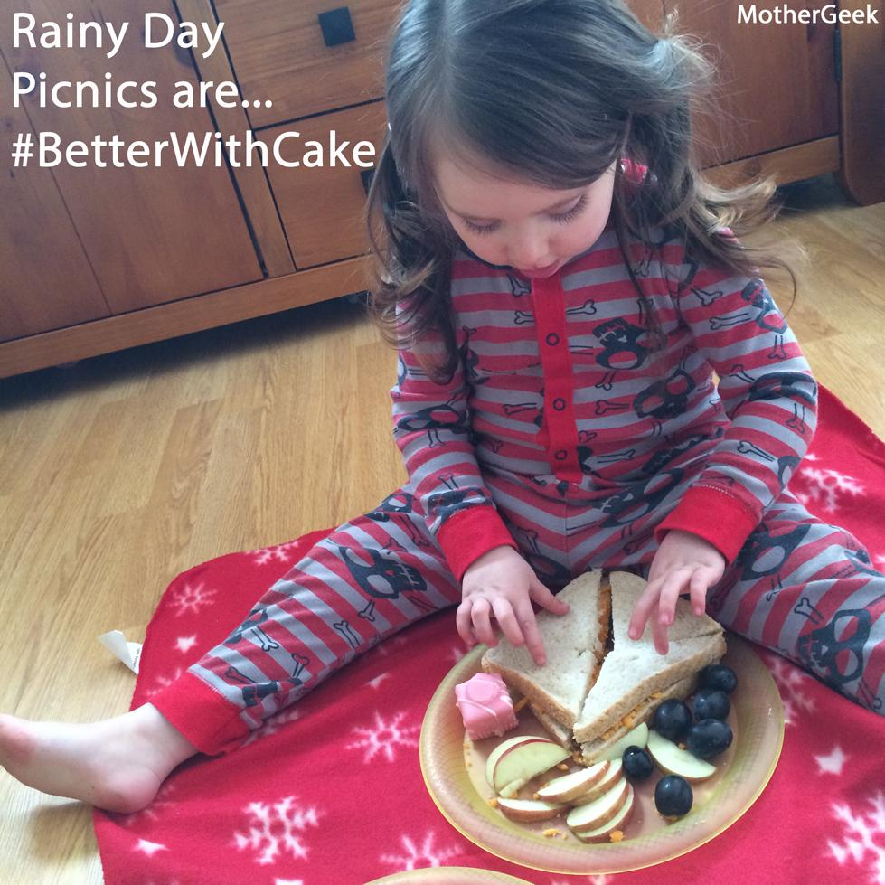 Toddler eating an indoor picnic complete with Mr Kipling cake - Better With Cake