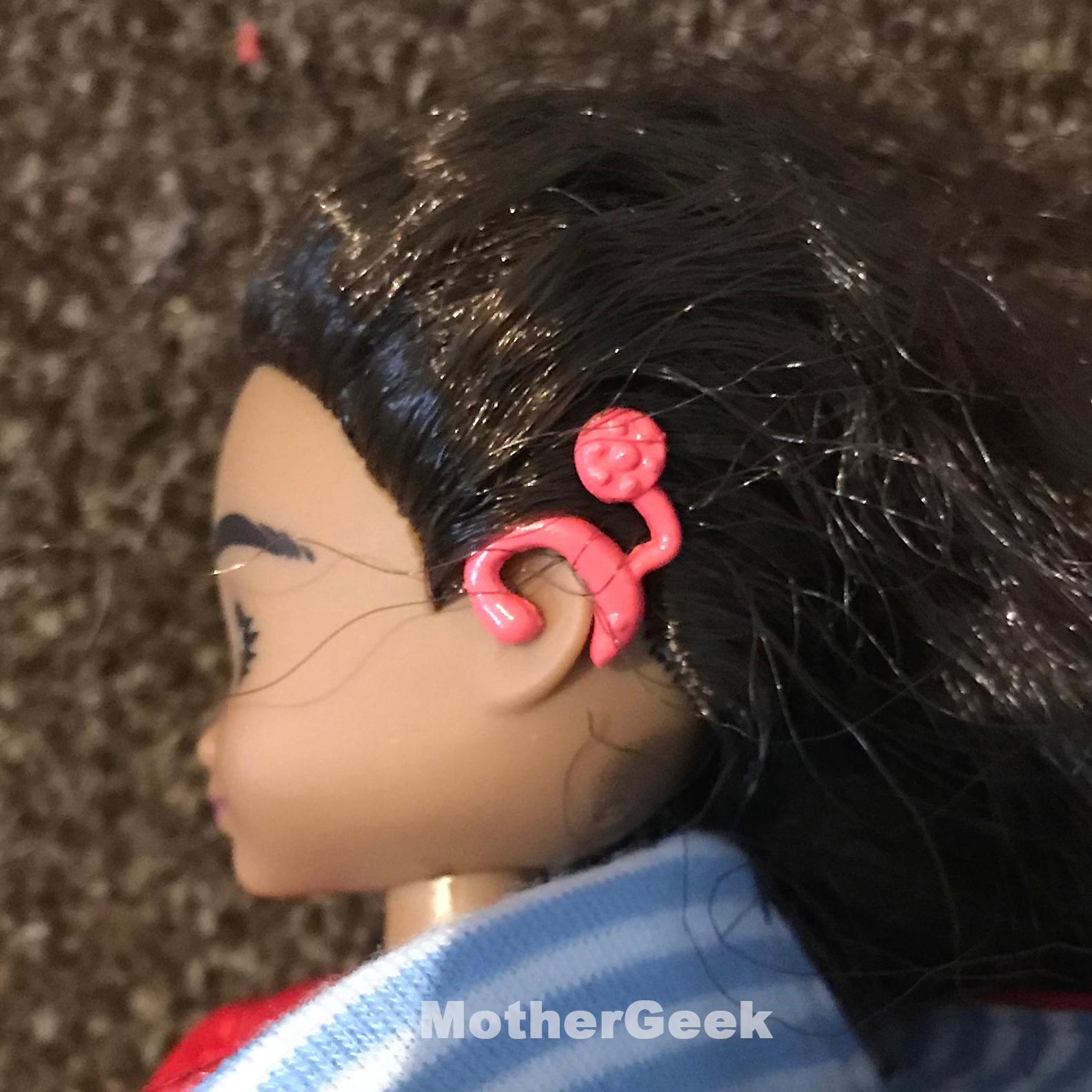 Wildlife Photographer Mia Doll - close up of hearing aid