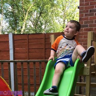 TP Forest Wavy Slide toddler boy on slide