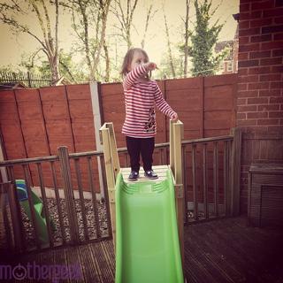 TP Forest Wavy Slide - Toddler stood on slide