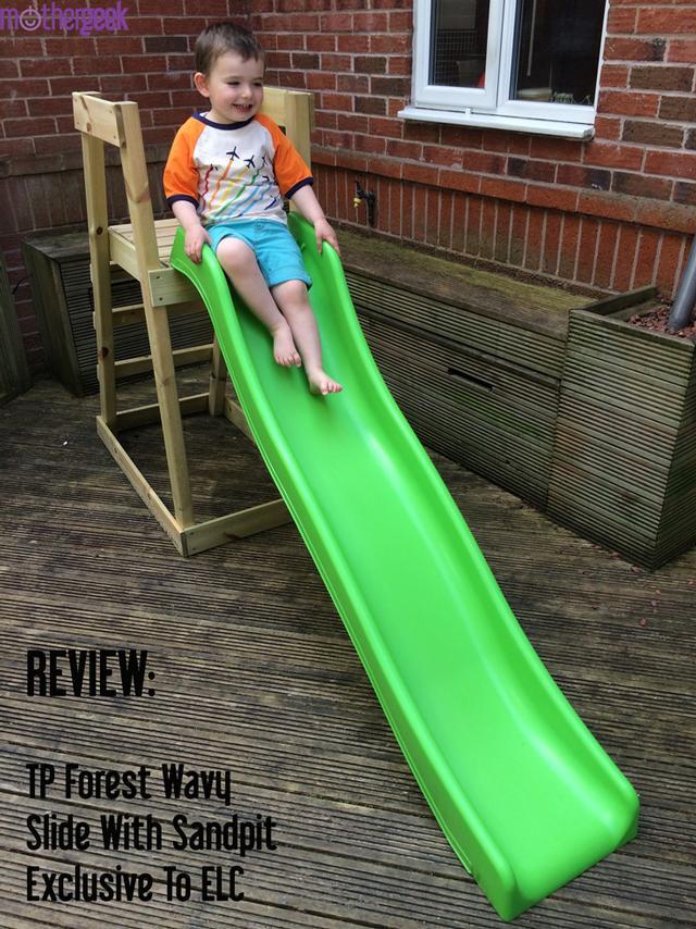 TP Forest Wavy Slide - toddler excitedly sat on slide