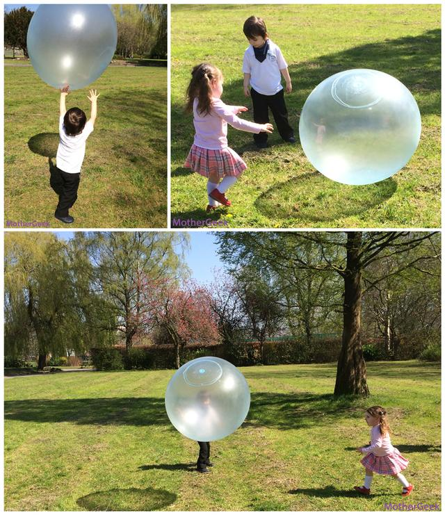 Wubble Bubble Ball on grass with 2 kids