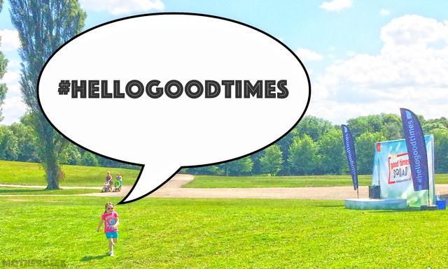 Girl running on grass with cartoon speech bubble saying #HelloGoodTimes